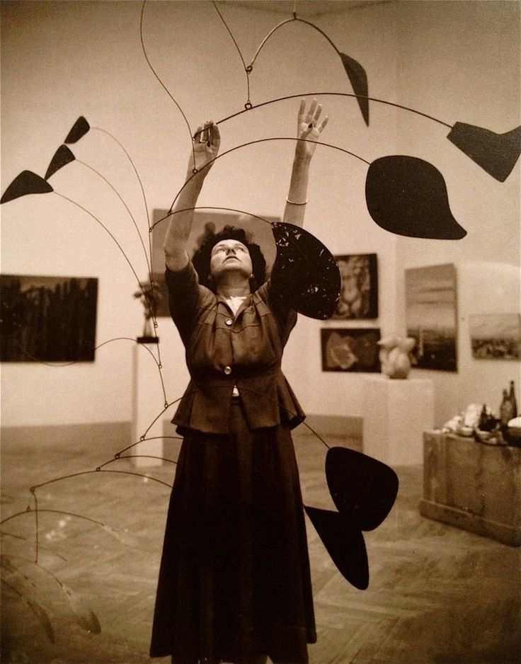ronulicny:  American Heiress / Collector / & the former Mrs. MAX ERNST: PEGGY GUGGENHEIM with an ALEXANDER CALDER mobile c. 1948….