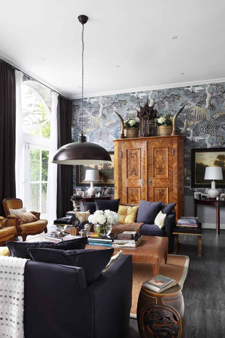 Drawing room in converted stable featuring Zoffany wallpaper and antiques