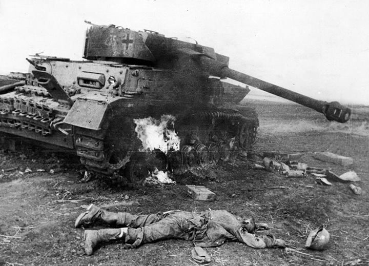 A knocked out German Panzer & one if its supporting infantry at the Battle of Kursk (5 July-23 August 1943). A war of attrition; the USSR out produced Germany and this is what did for the Nazis. The USSR could produce 10 tanks for every 1 German tank.