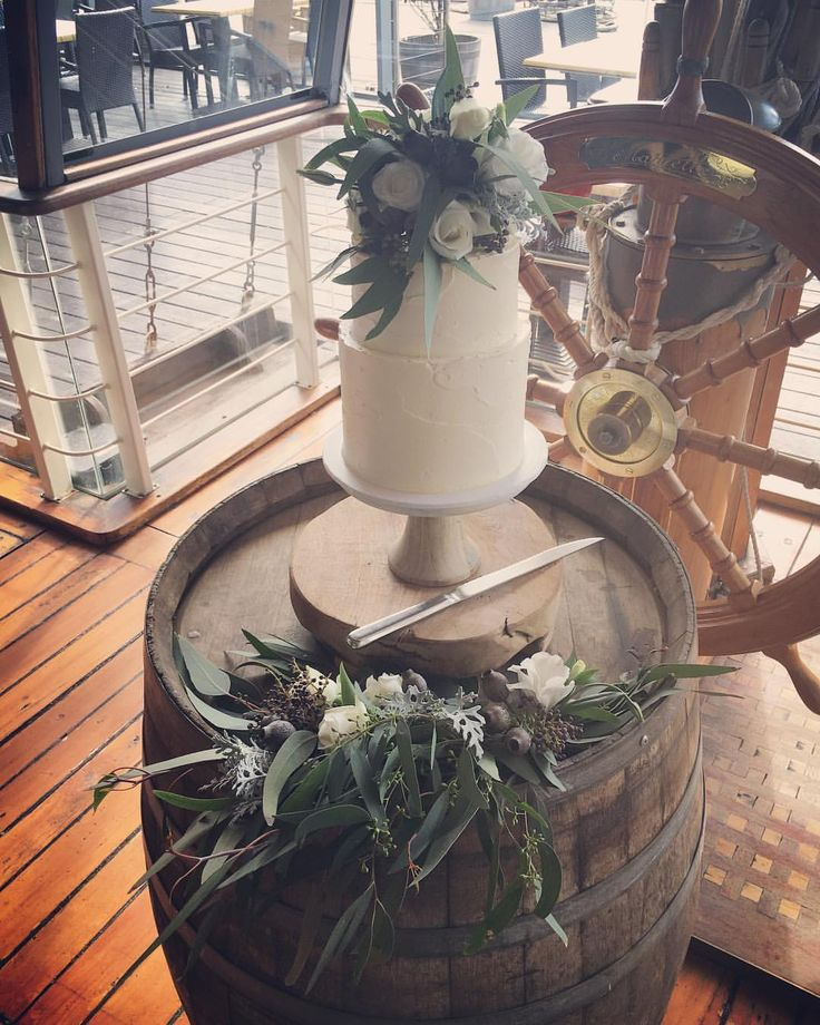 Wedding cake flower topper and wine barrel arrangement by Hunting Blooms