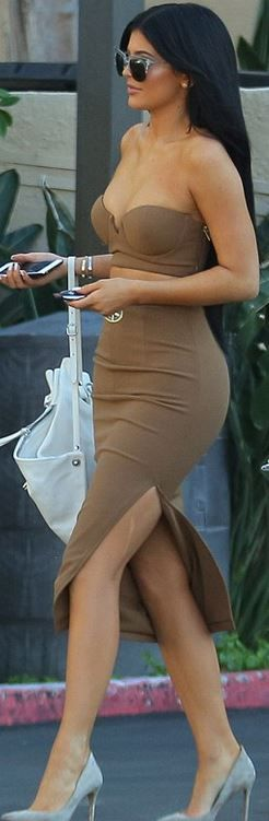 Kylie Jenner: Shirt and skirt – House of CB  Shoes – Gianvito Rossi  Bracelet – Cartier
