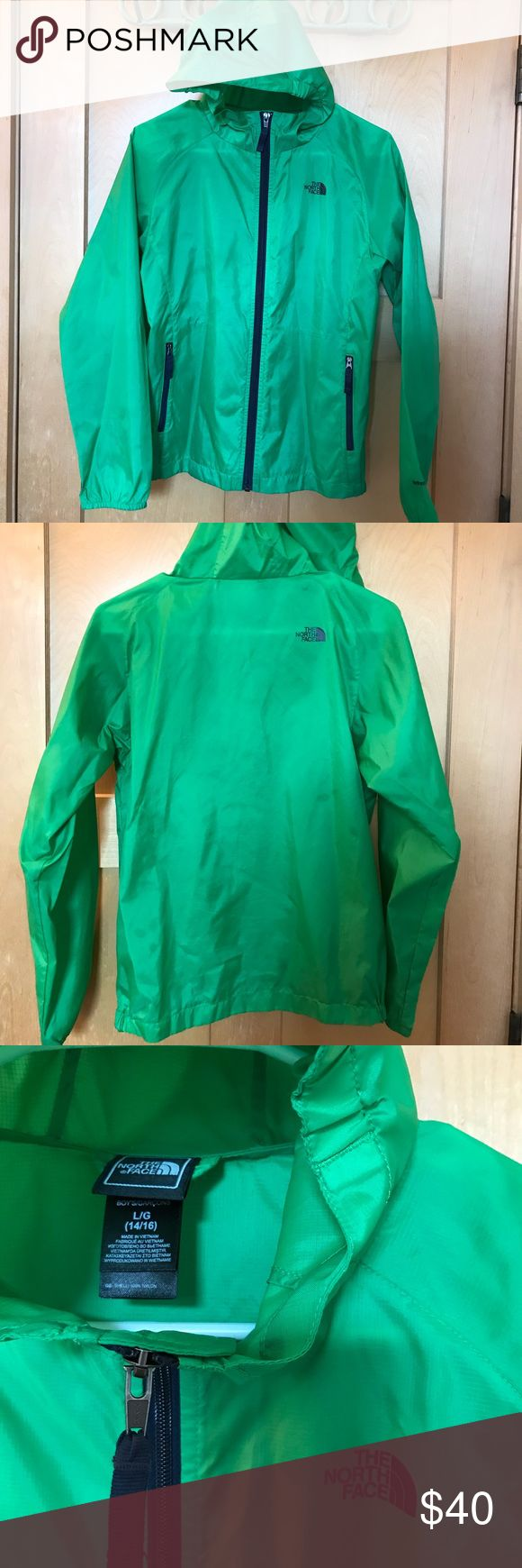 North Face windbreaker North Face green windbreaker. Children's 14-16. I am a woman's XS/S in North Face and this fits perfect. Like new North Face Jackets & Coats