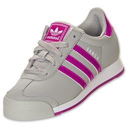 Whether she's on the field or the playground, the sporty style of the adidas Samoa Leather Casual Shoes are the perfect sneakers for active kids. These ultra-popular '80s throwbacks are back in a big way in a wide variety of colors sure to match everything she owns.   Made of full grain leather that is soft and comfortable for all-day wear, these original soccer shoes are made to handle all types of activities. The suede toe overlay and adidas stripes add instant style, while the tr...