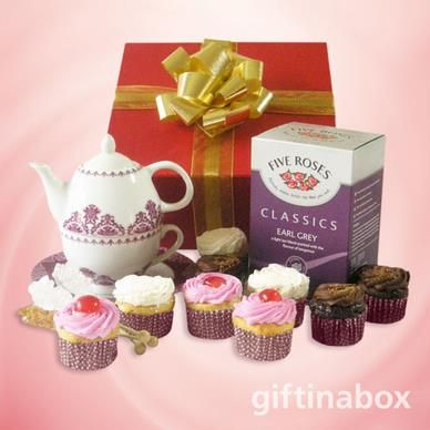 A selection of fine tea and tantalizing cupcakes, enjoyed with your very own teapot and tea cup with saucer. Just add sugar!. All goods are lovingly presented in a red box decorated with gold ribbons and tissue paper.   Five Roses classic Earl Grey tea 9 assorted cupcakes in chocolate, vanilla and strawberry flavours 2 crystallised sugar sticks All in one tea pot with tea cup and saucer