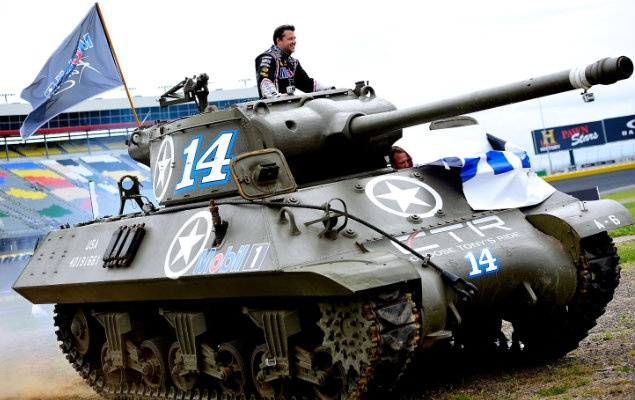 Breaking out the big gun: Tony Stewart rides in a World War II-era tank. (Getty Images)