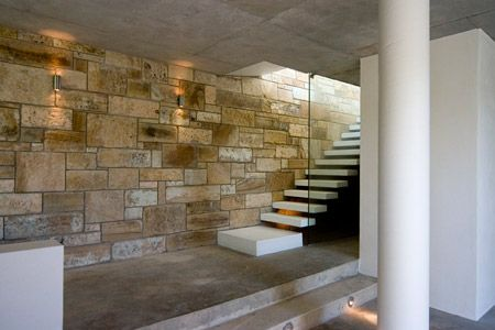 Leaf House by Undercurrent Architects - Dezeen  love the contradiction between white column and stone wall
