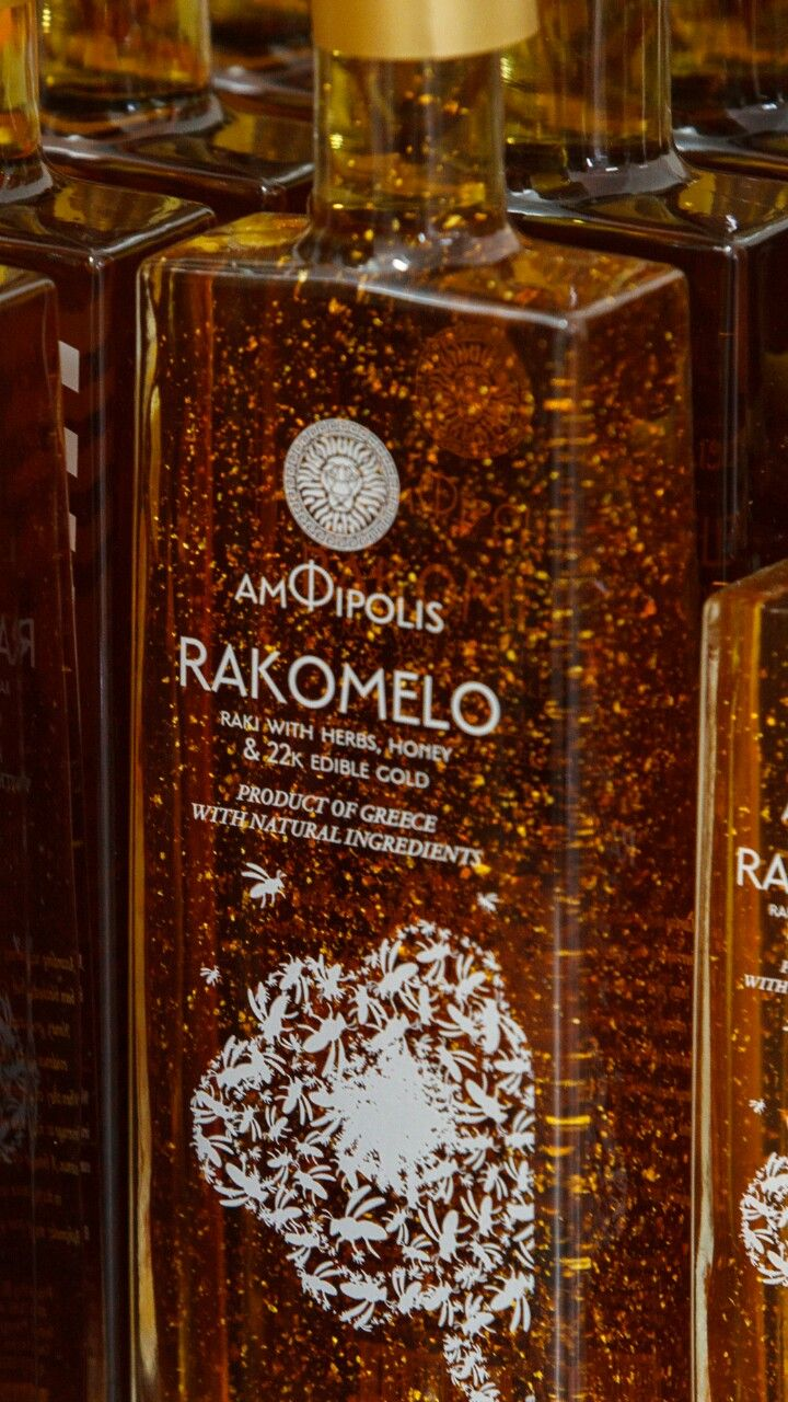 When precious gold dives in pure honey! Amazing rakomelo with gold.  Amphipolis raki with honey and edible gold | Amfipolis transparent label logo