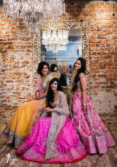 bridesmaids , elegant sister of the bride outfits , pink floral lehengas, girly pastel lehengas, engagement lehenga , sangeet lehenga , excited bridesmaids , engagement lehenga , coordinated lehenga