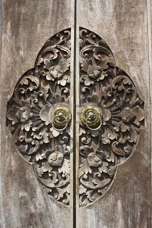 Detail of carved and weathered Balinese Wooden Doors.