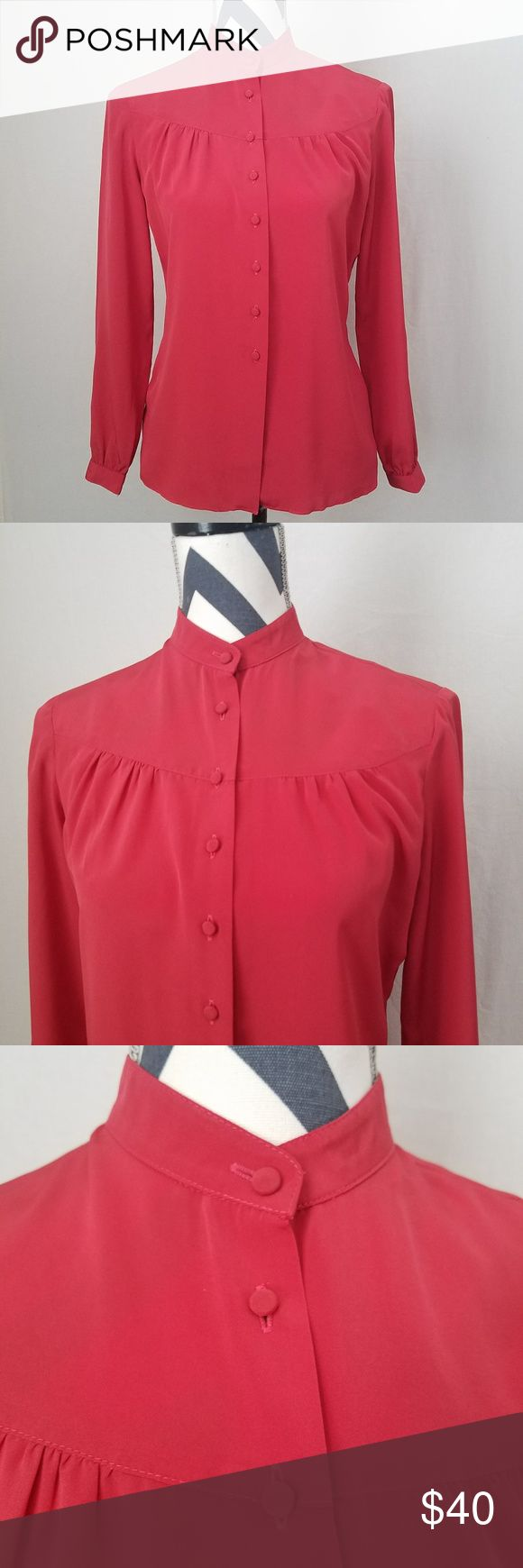 "VINTAGE 70's St. John Blouse BEAUTIFUL Vintage 70's St. John blouse in a bold, brick red. This fabulous top features buttons down the front in the same red polyester fabric, a mandarin collar, long sleeves, and gathering across the bust and back. All these features come together to give this blouse a very Victorian feel.  size 6 39"" bust 25"" length 22.5"" sleeves measured from the shoulder seam Some very light spots located at underarms, but they are very faint. If it weren't for these spots…"