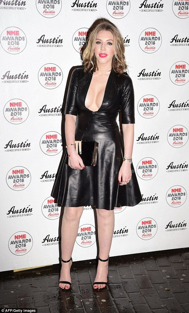 The black leather dress featured a neckline slashed to the navel to showcase the funny woman's cleavage