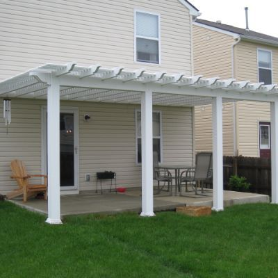 "This white vinyl pergola was installed in 2009 creating a shaded living area.  Rear of home faced west making it difficult for homeowner to utilized their space.  These vinyl pergolas allow extra shading based on the louvered 3"" slats.  Project completed in Columbus, Ohio, Pickerington, Ohio"