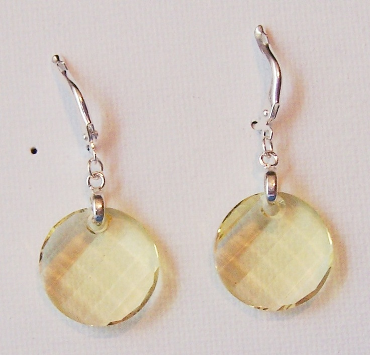 Simple, yet elegant earrings. Swarovski faceted button focal in Jonquil on silver plated earwires.
