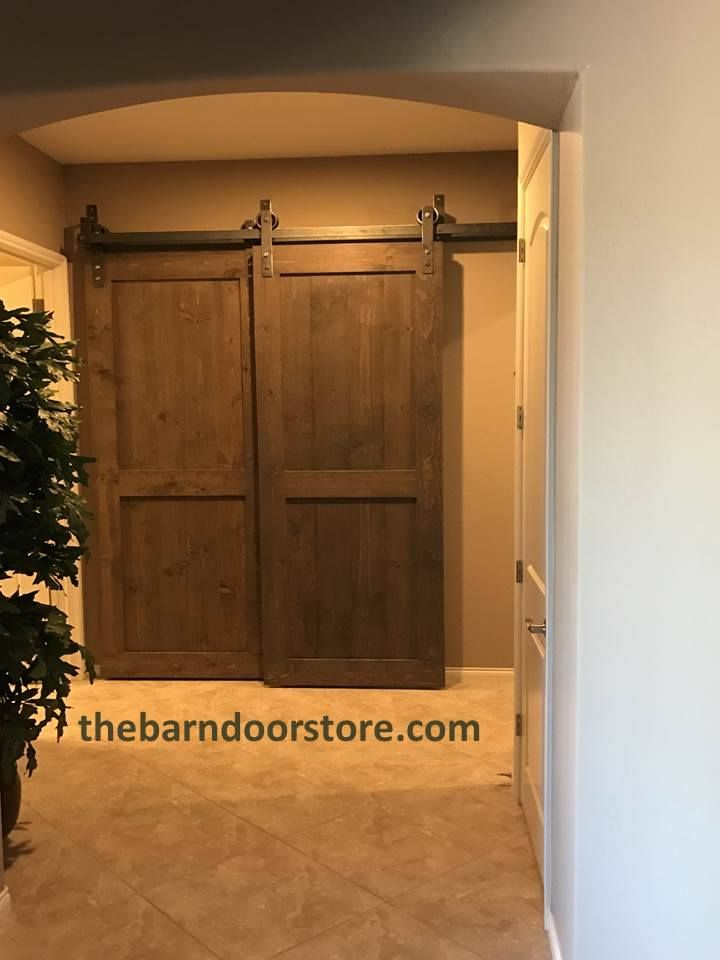 """A couple of last minute barn doors in place just in time for Thanksgiving. The """"distressed Spanish blue"""" barn door over a hallway entrance and the pair of """"mushroom gray"""" barn doors over the entrance to a den which can now be used as a guest room as well. Happy Thanksgiving everyone!! www.thebarndoorstore.com"""