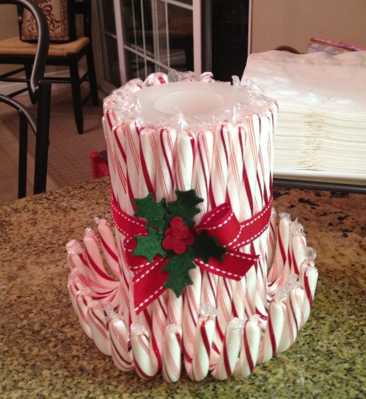 easy candy cane candle, take a candle and wrap any of your favorite candy cane flavors around it... and your done beautiful centerpiece