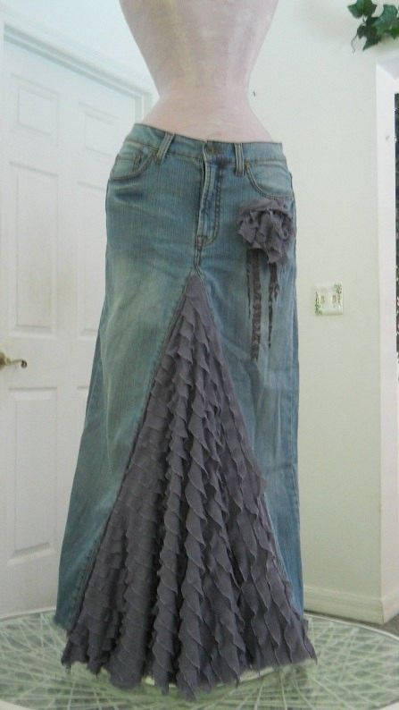 I've always wanted to turn old jeans into a skirt...I never thought about using fabric for the inset. by myrtle