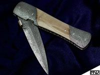 Mastersmith Michael Vagnino Blade - Masaic Damascus Bolsters - Mosaic Damascus Steel - 1084 - 1095 - 25n20 Scales - Walrus Ivory Liners - Titanium Blade length - 3 OAL 6 1/2  Closed 3 1/2
