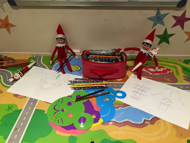 December 23rd - cheeky elves are drawing and colouring in on the train table.