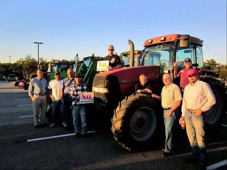 Staff photo by PAUL S. WARNER  Farmers stand outside the county government building in La Plata next to parked tractors to show opposition to the septic bill and staff tier map. From left, David Lines of La Plata, Bruce Culver of Charlotte Hall, Peter Weber of Dentsville, Clayton Hancock of La Plata, Patrick Weber of Dentsville, Chip Bowling of Newburg. Bill Higgs of Newburg, Charles Bowling of Newburg and David Hancock Jr. of La Plata.