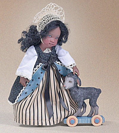 Kish Little Mary with Rolling Lamb Doll 2007 is 7.5 inches tall and is Item No. HKE0532 at my Tias site, http://www.donnaskorner.com.