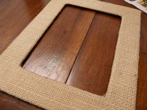 burlap mat.  I wouldn't even buy a frame, just take cardboard cover, adhere your photo to the back, add hanger and then hang.  Informal, lightweight too.