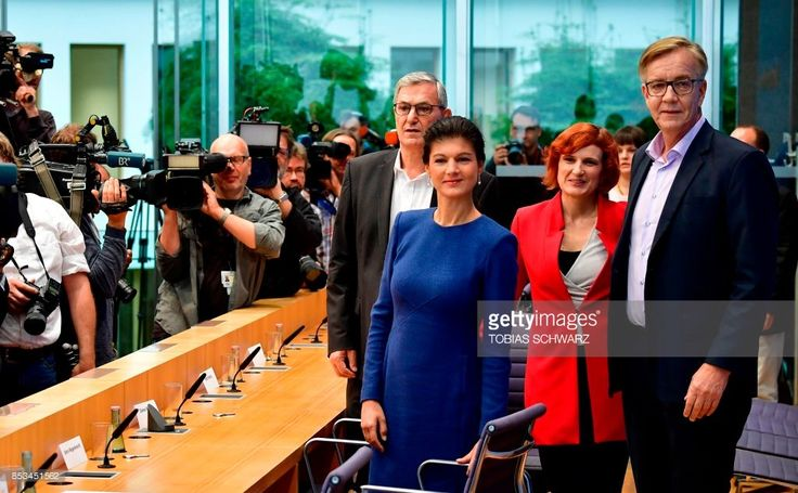 Co-leaders of the left-wing Die Linke (The Left) party Bernd Riexinger (L) and Katja Kipping (2ndR) and top candidate of Die Linke Sahra Wagenknecht (2ndL) and Dietmar Bartsch pose for photographers prior to a press conference in Berlin on September 25, 2017, 1