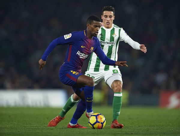 Nelson Semedo of FC Barcelona (L) competes for the ball with Cristian Tello of Real Betis Balompie (R) the La Liga match between Real Betis and Barcelona at Estadio Benito Villamarin on January 21, 2018 in Seville, . - 46 of 81