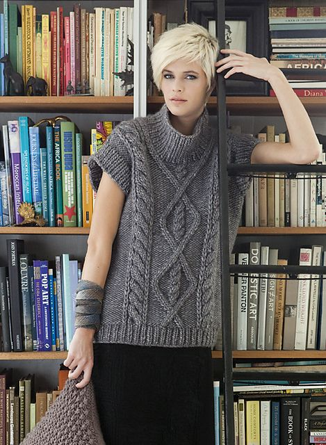 "Cap sleeves are the key to the three-season versatility of MARI LYNN PATRICK's gorgeous cabled topper, knit in Schulana/Skacel Collection's softly mottled ""Cortina Nuvole."""