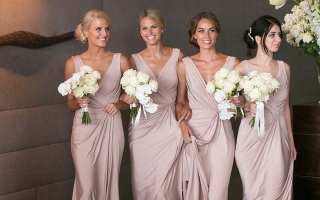 Dusky pink bridesmaid dresses from White Runway. Image: Blumenthal Photography