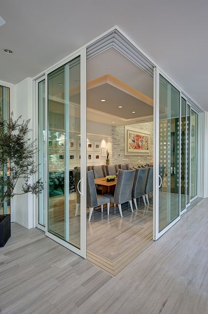 Love the slider wall that opens this dining room to the lanai.