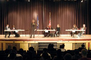 Roosevelt High School students witness court proceedings in school auditorium.