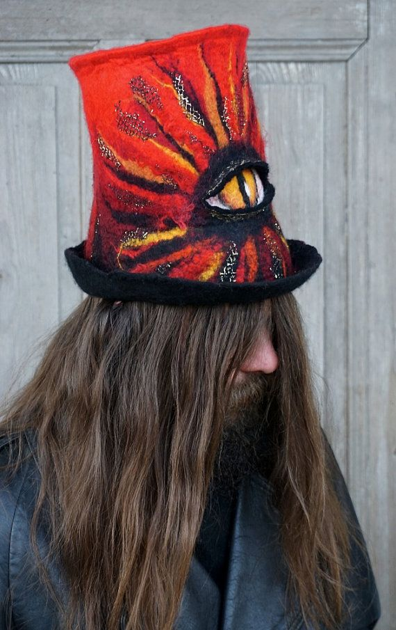 This red&black unique felted top hat with devil or Sauron eye and pentagram on the top can be an original head gear for Black metal fan for any festival occasion or perfect complement to original outfit ! I made it with merino wool and golden mesh which adds the glitter effect. Unique high hat for unique men or women. Dark and crazy! Ideal for people who like to stand out from the crowd!  Head circumference 56 - 58 cm ( 22 - 23) height - 24 cm ( 9,5)