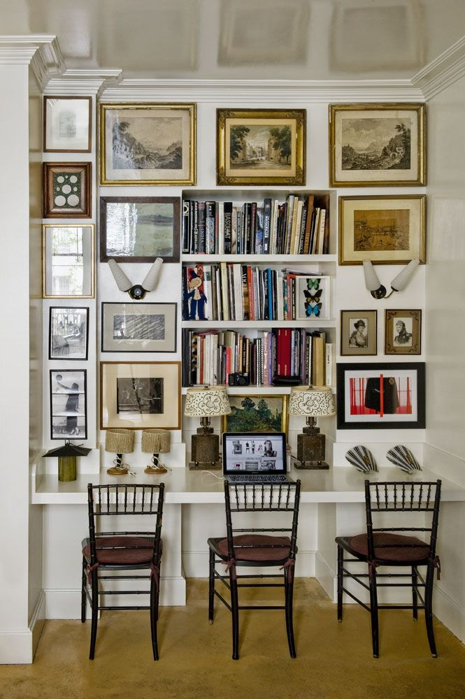 salon wall and bookshelves in a home office // workspaces
