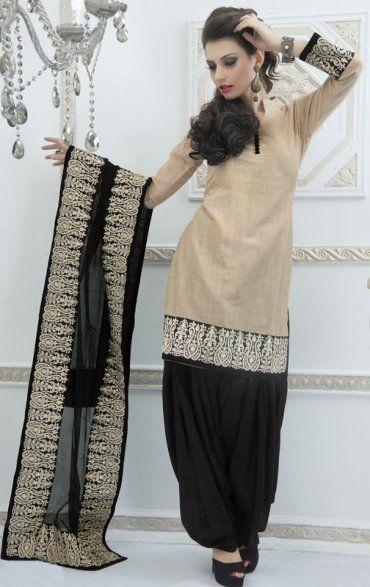 Beige And Black Color Silk Party Wear Salwar Kameez fabric:-Silk Bottom :- Contrast Color Churidar. Dupatta :- Matching Dupatta. Sale: $113.40
