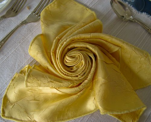 """Lovely """"rose"""" folded napkin. It's the small touches that make your table setting special!"""