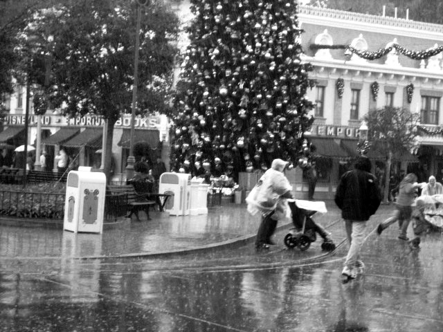 """Rainy Day at Disneyland, """"The Hub"""" Main Street USA, Disneyland, The Disneyland Resort, Anaheim, CA"""