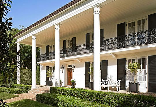 A southern antebellum style house built in 1939 is for Southern style homes with wrap around porch for sale