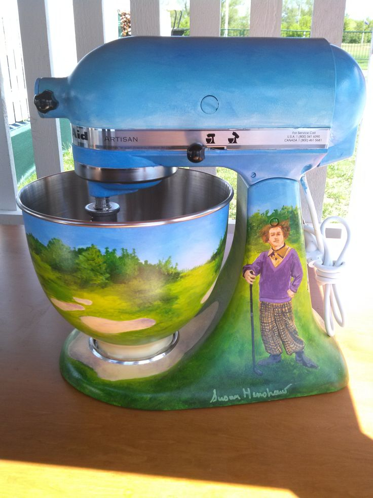 www.AuctionToday.co  KitchenAid stand mixer, autographed by pro golfer Andy North and painted by Susan Henshaw, that was auctioned off at the 75th Senior PGA Golf Championship in Benton Harbor, MI.  The theme is The Three Stooges.