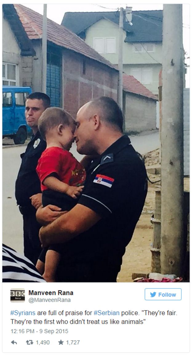 picture of policeman hugging boy