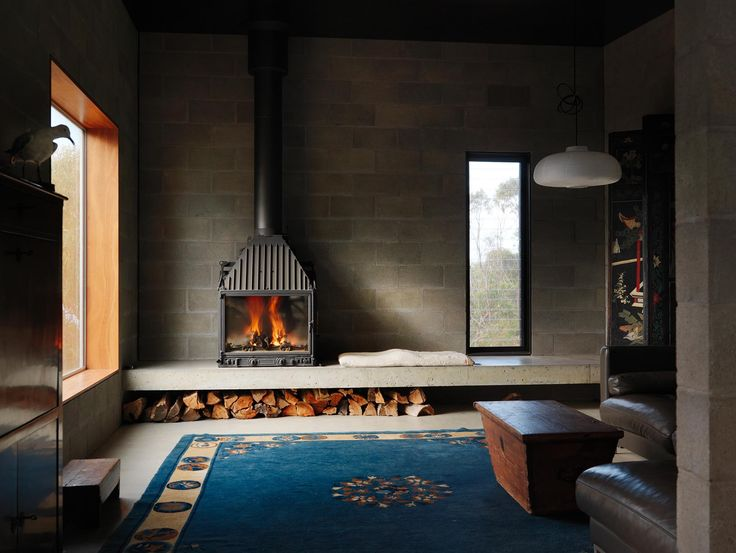 living room as private space due to smaller windows and fireplace to create a place of refuge.