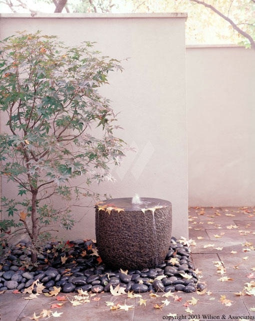 Understated modern water feature that enhances the corner