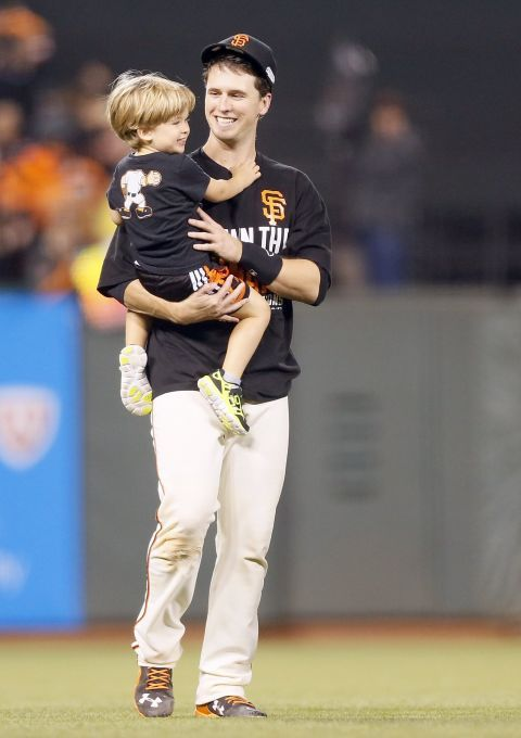 More so stinking cute! Giants Buster Posey carries his son, Lee, after Game 5 of the NLCS at AT&T Park on Thursday, Oct. 16, 2014 in San Francisco, Calif. Photo: Beck Diefenbach, Special To The Chronicle