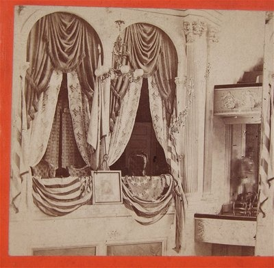 1865 Abraham Lincoln Assassination Stereoview photograph of Presidential Balcony Box at Ford's Theatre where John Wilkes Booth committed the murder. Photo taken 2 days after the assassination with the Box remaining exactly as it appeared after Booth's leap to the stage below. The assassin's spur caught either the picture of George Washington seen between the two boxes or the American Flag that was draped as bunting below the opening of the Presidential Box (note torn piece of flag).