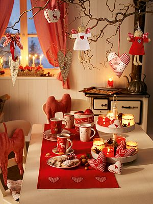 I love the stand center piece with the pin cones and candles in jars and fabric hearts!