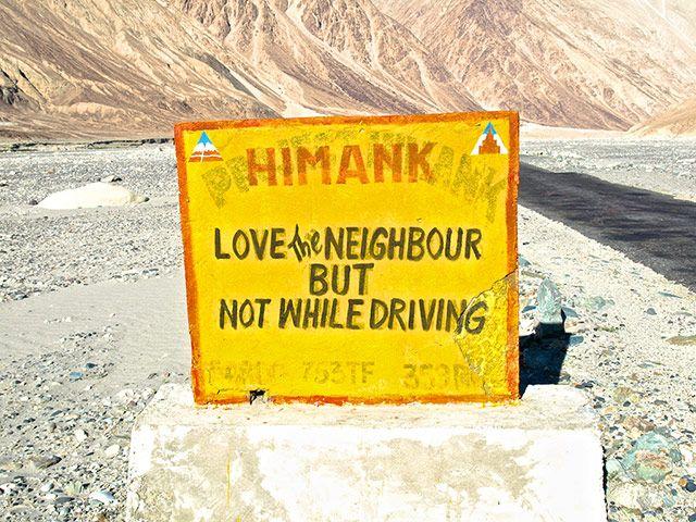 Credit: Ajay Jain /Barcroft Media  - road sign in the Himalayas