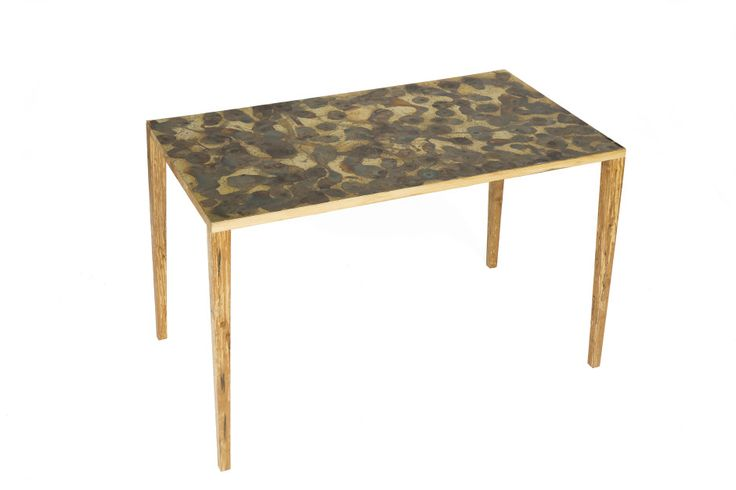 A table with chemically induced verdigris.  Designer: Veronica Ronn