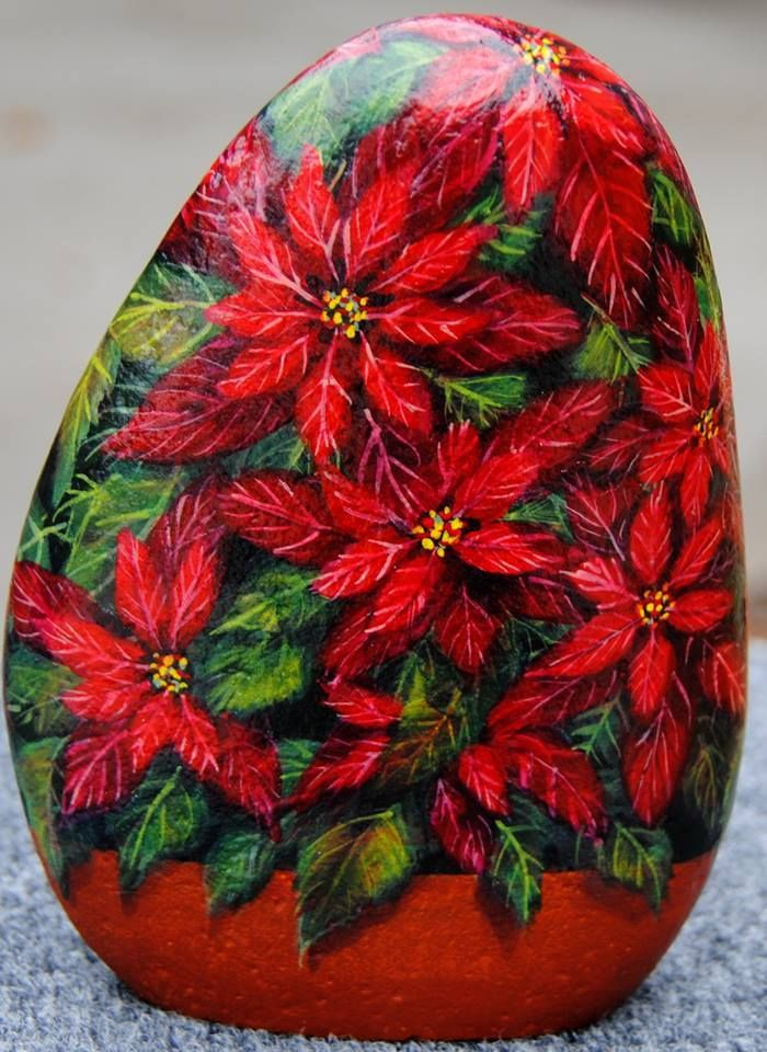 poinsettia What a Gorgeous Idea for Painting Rocks!!! This Christmas Rock is beautiful, I will keep this for reference & inspiration!!!