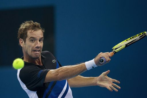 Richard Gasquet of France returns a shot to Novak Djokovic of Serbia during the semifinal match of the China Open tennis tournament at the National Tennis Stadium in Beijing, China Saturday, Oct. 5, 2013. (AP)