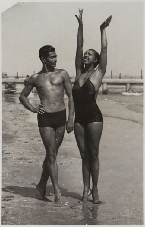 """The """"Ebony Venus"""" and the """"Bronze Apollo"""" - Josephine Baker and the Russian-born French ballet legend, Serge Lifar, on the Lido beach in Venice, 1930s. Ms. Baker talked about this day in """"Josephine,"""" the biography she wrote with her formerhusband, Jo Bouillon, which was published in 1976, one year after her death.""""We had had a wonderful time together on the beach in Venice during my Italian tour. I loved to hear Serge speak. He was more entertaining than all the pigeons ..."""