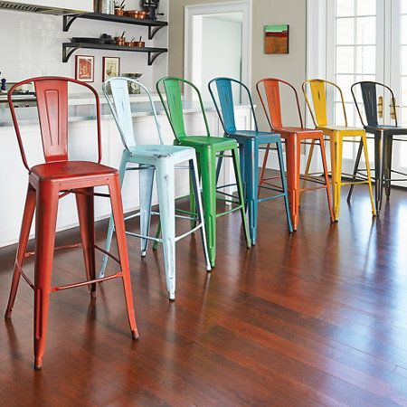 Add vintage charm to your kitchen table or counter with these distressed bar stools with back. Available in 2 sizes and 9 fun colors.